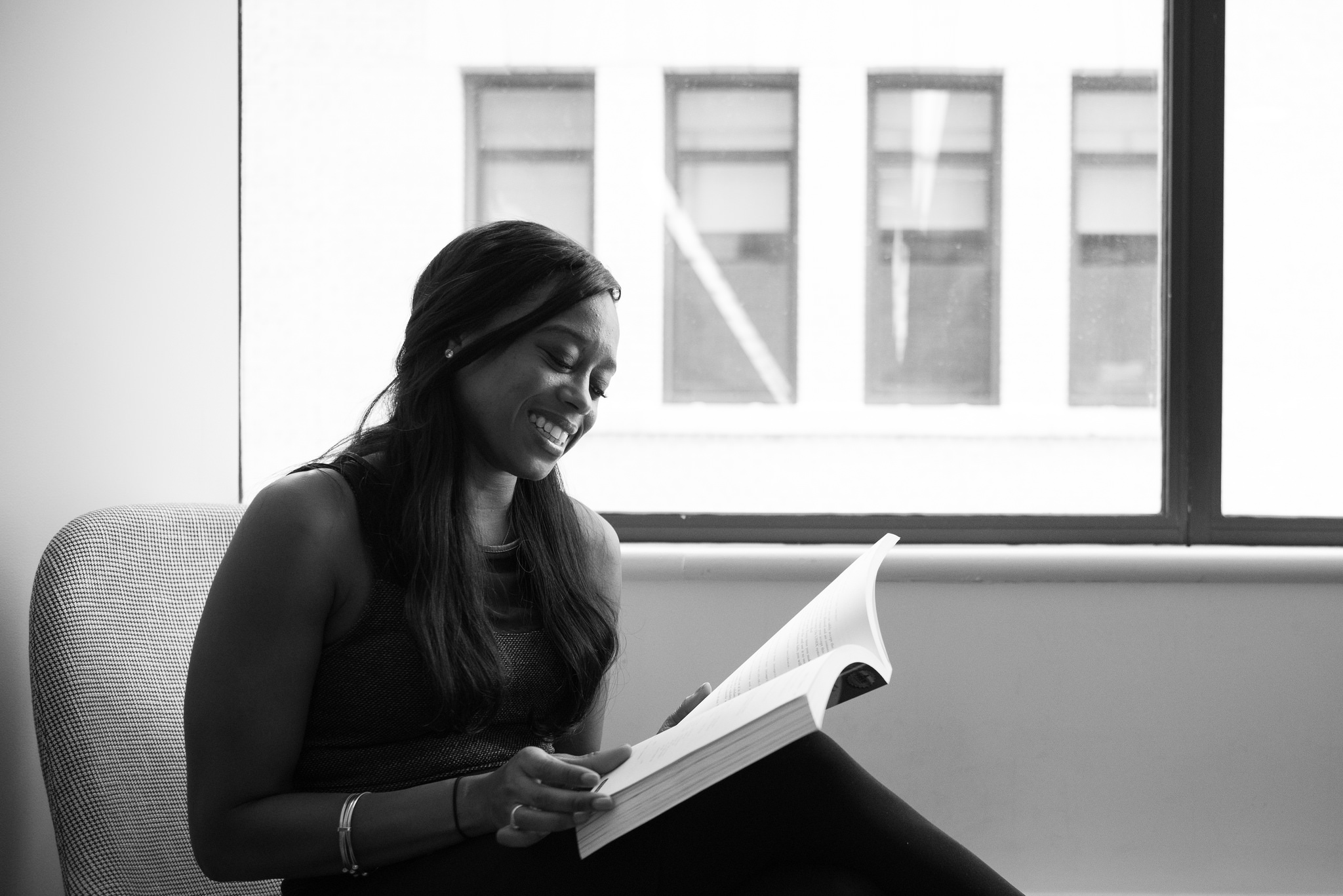 black woman reading